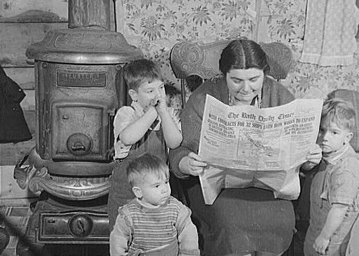 vintageNewspaperReadingFamily